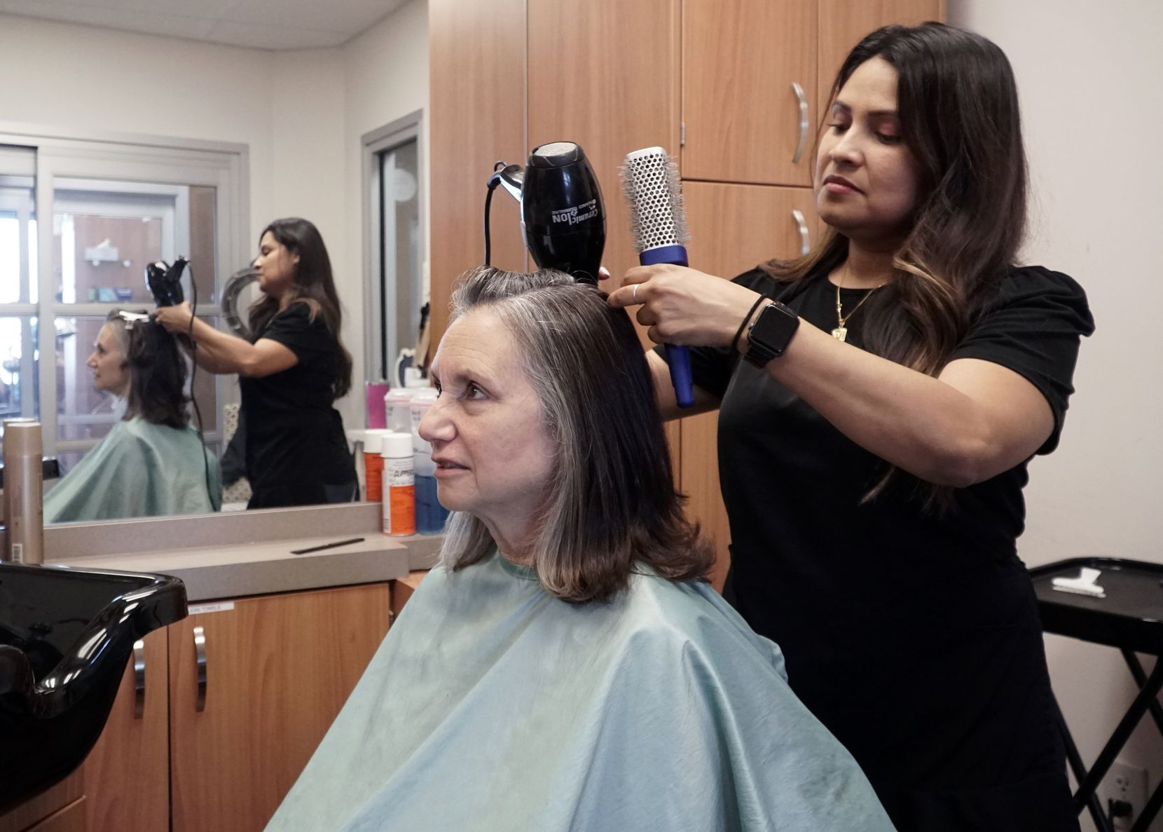 Hairstylist Veronica Vazquez helped Harriet Blake go gray gracefully by adding lowlights to diffuse and blend with the gray hair until it was fully grown out.