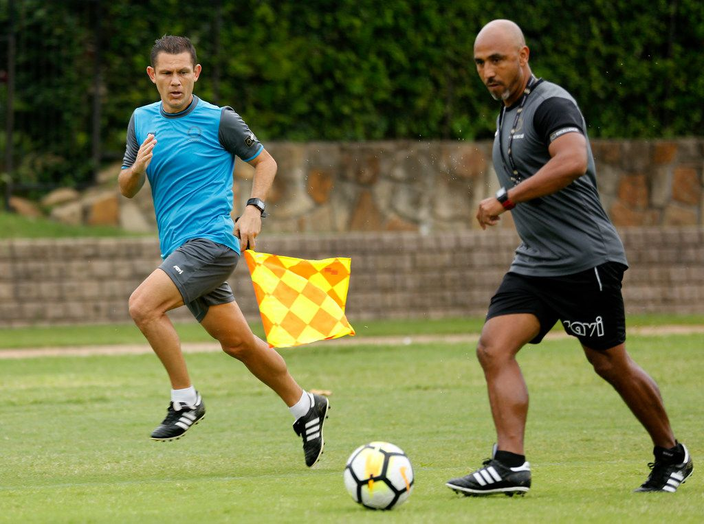 CONCACAF soccer assistant referee William Arrieta of Costa Rica (left) watches to see if instructor Jose Luis Camargo goes out of bounds during a workout at Andrew Brown Park West in Coppell, Texas, Monday, June 24, 2019. The group of refs stay in shape and on-point as they workout between ongoing Gold Cup matches. Dallas-Fort Worth is the location of the base camp because its easy to get to and from the games in North and Central America by being located in the central part of the U.S. and near DFW Airport. (Tom Fox/The Dallas Morning News)