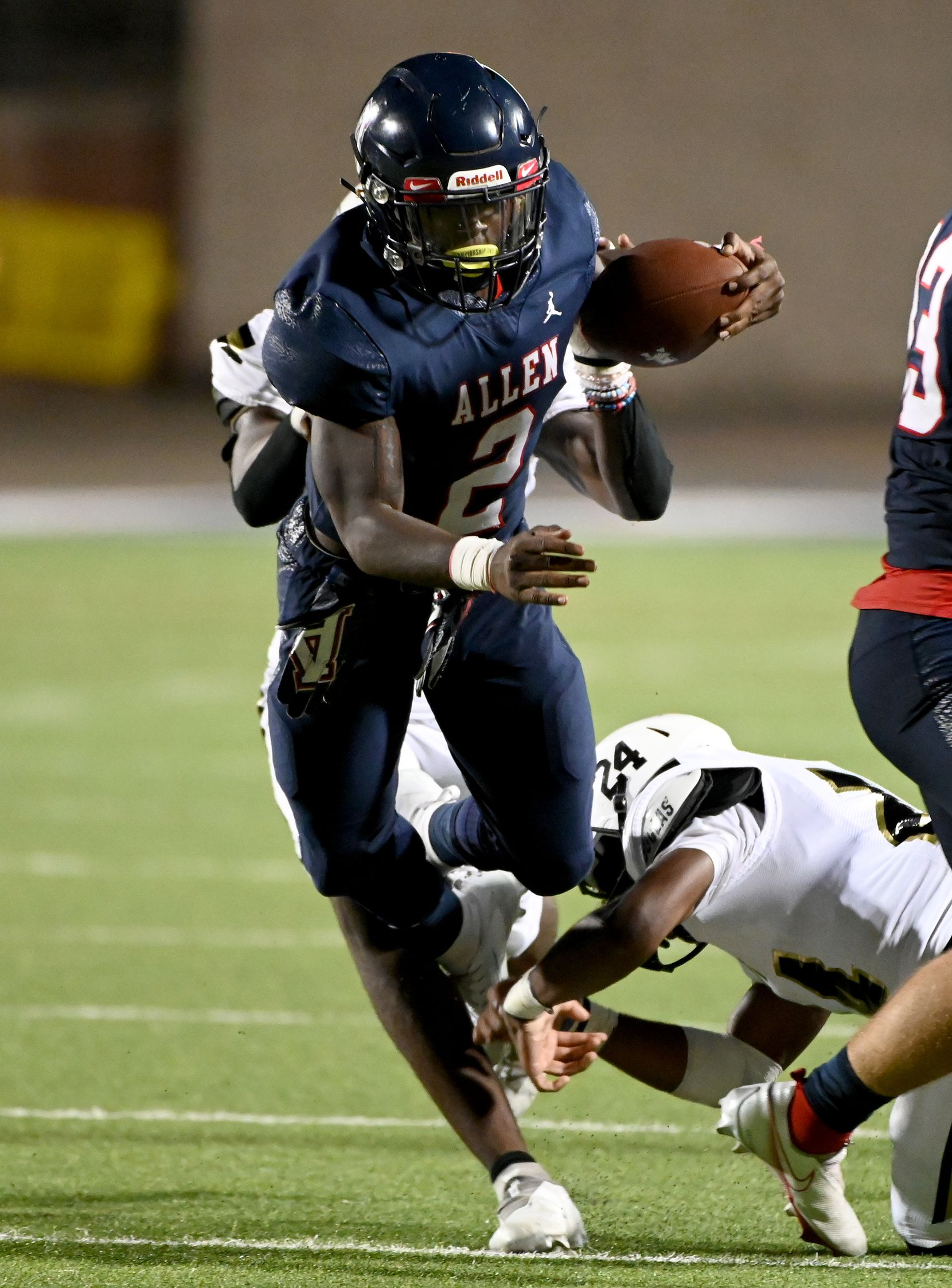 Allen's Jaylen Jenkins (2) runs through tackle attempts by Plano East's Daniel Oliver and Ahmari Malone (24) in the second half during a high school football game between Plano East and Allen, Friday, Aug. 27, 2021, in Allen, Texas. (Matt Strasen/Special Contributor)