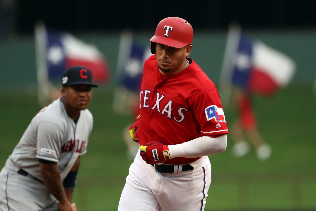 ARLINGTON, TEXAS - JUNE 19:  Asdrubal Cabrera #14 of the Texas Rangers runs after hitting a homerun against the Cleveland Indians in the second inning at Globe Life Park in Arlington on June 19, 2019 in Arlington, Texas. (Photo by Ronald Martinez/Getty Images)