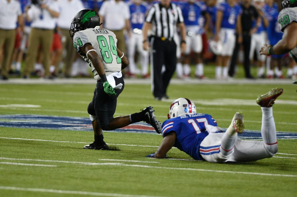 Caption North Texas freshman wide receiver Jaelon Darden (84) escapes a tackle from Southern Methodist linebacker Jordon Williams (17). UNT faced off against SMU on Saturday at Gerald J. Ford Stadium in Dallas. Saturday, September 9, 2017, Gerald J. Ford Stadium in Dallas, Texas. Jake King/DRC ORG XMIT: txder