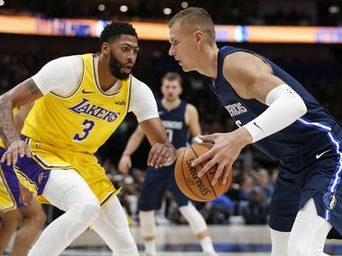 Dallas Mavericks forward Kristaps Porzingis (6) drives on Los Angeles Lakers forward Anthony Davis (3) during the second quarter of play at American Airlines Center in Dallas on Friday, November 1, 2019. (Vernon Bryant/The Dallas Morning News)
