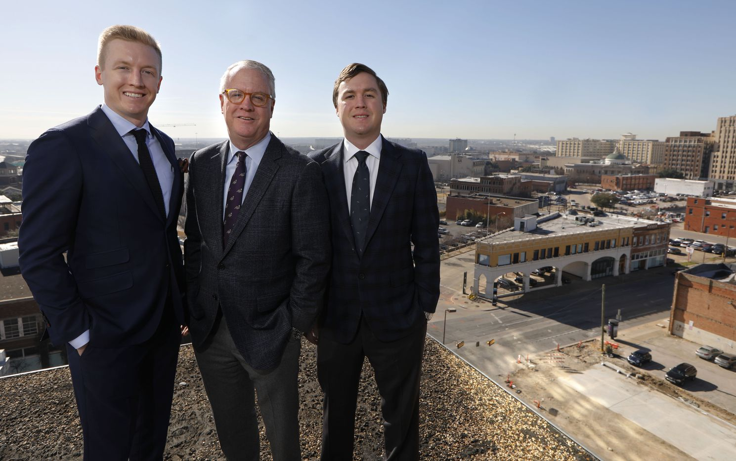 Shawn Todd, founder and CEO of Todd Interests, center, with his sons, Patrick, left, and Philip of Todd Interests, pose for a portrait from the roof of one of their buildings, located at 2200 Main St. in downtown Dallas.