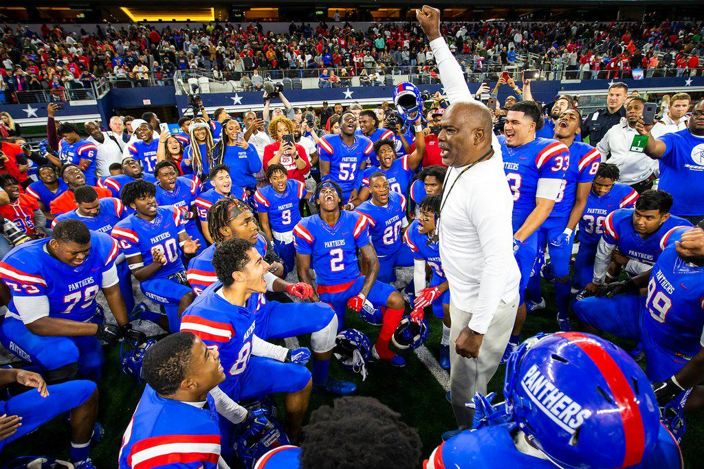 Duncanville players circle around head coach Reginald Samples after a 44-35 victory over Allen in Class 6A Division IÊstate semifinal at AT&T Stadium on Saturday, Dec. 15, 2018, in Arlington. (Smiley N. Pool/The Dallas Morning News)