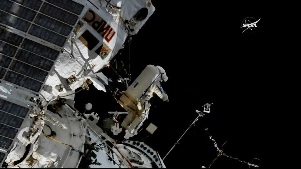 In this image made from a video, cosmonaut Sergey Prokopyev flings a Sirius nano-satellite into orbit from the International Space Station on Wednesday, Aug. 15.