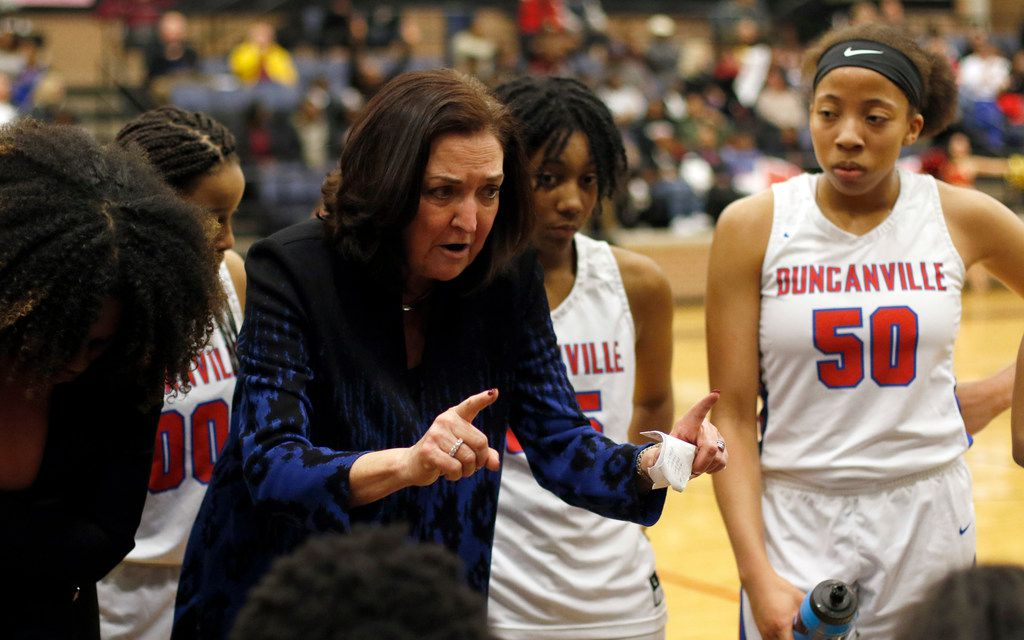 Duncanville head coach Cathy Self-Morgan speaks with her players during a timeout in the second half of their game against South Grand Prairie. The two teams  played their Class 6A bi-district girls basketball playoff game at Mansfield Timberview High School in Arlington on February 12, 2019. (Steve Hamm/ Special Contributor)