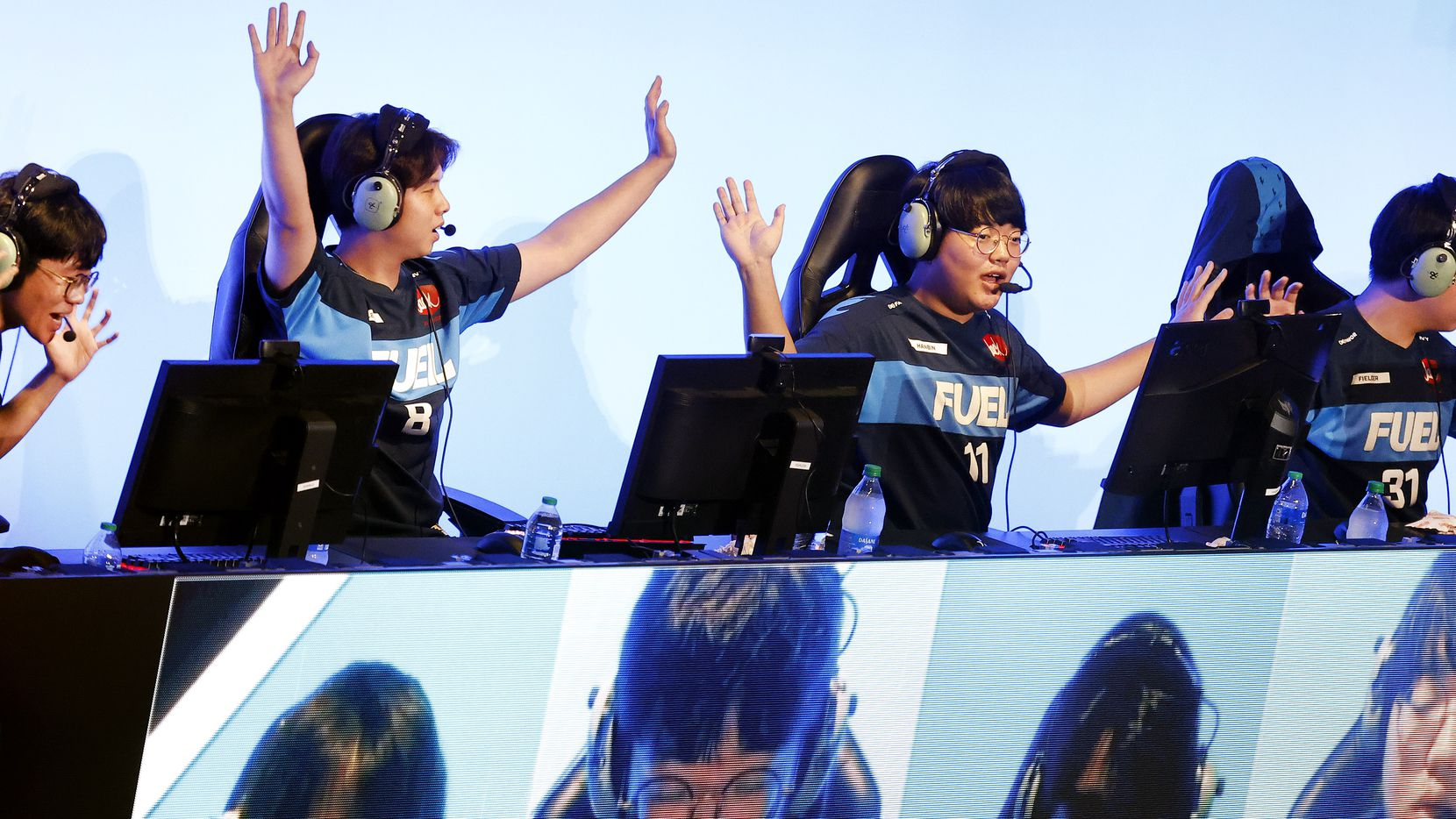 """Dallas Fuel team members (from left) Kim 'Sp9rk1e' Yeonghan, Lee """"Fearless"""" Eui-Seok, Choi 'Hanbin' Hanbeen and Kwon 'Fielder' Jun celebrate their Overwatch League win over the Houston Outlaws at Esports Stadium Arlington Friday, July 9, 2021. Dallas Fuel defeated Houston in The Battle for Texas, 3-0. It was the first in-person live competition for fans in over a year. Houston competed from their hometown. (Tom Fox/The Dallas Morning News)"""