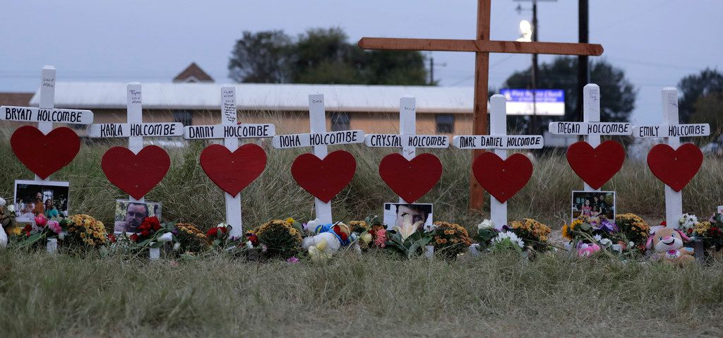 FILE - In this Nov. 10, 2017 file photo, crosses for members of the Holcombe family are part of a makeshift memorial for those who were killed in the Sutherland Springs Baptist Church shooting in Sutherland Springs, Texas. The federal government is being sued for negligence by the Holcombe family that lost nine members during the mass shooting at the church last year. The suit says the federal government was negligent by failing to report the gunman's criminal information into a national database. (AP Photo/Eric Gay File)