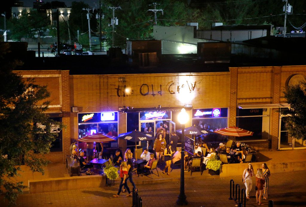 Patrons at The Old Crow have drinks on the patio on Aug. 24, 2019. Sara Hudson was on her way to celebrate her 22nd birthday. She never made it. She was found in a burning SUV just a few parking lots behind (upper left part of photo) restaurants and bars on Lower Greenville Avenue in Dallas.  Suspect Glen Richter, 49, has been booked into the Dallas County jail, charged with capital murder.