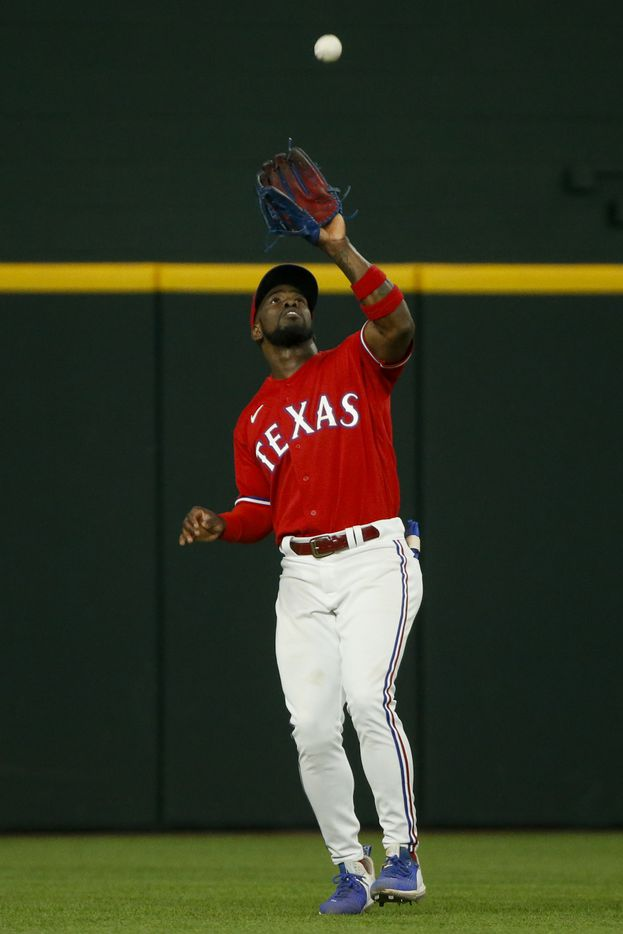 Texas Rangers center fielder Adolis Garcia (53) makes a catch to record an out during the sixth inning against the Kansas City Royals at Globe Life Field on Friday, June 25, 2021, in Arlington. (Elias Valverde II/The Dallas Morning News)