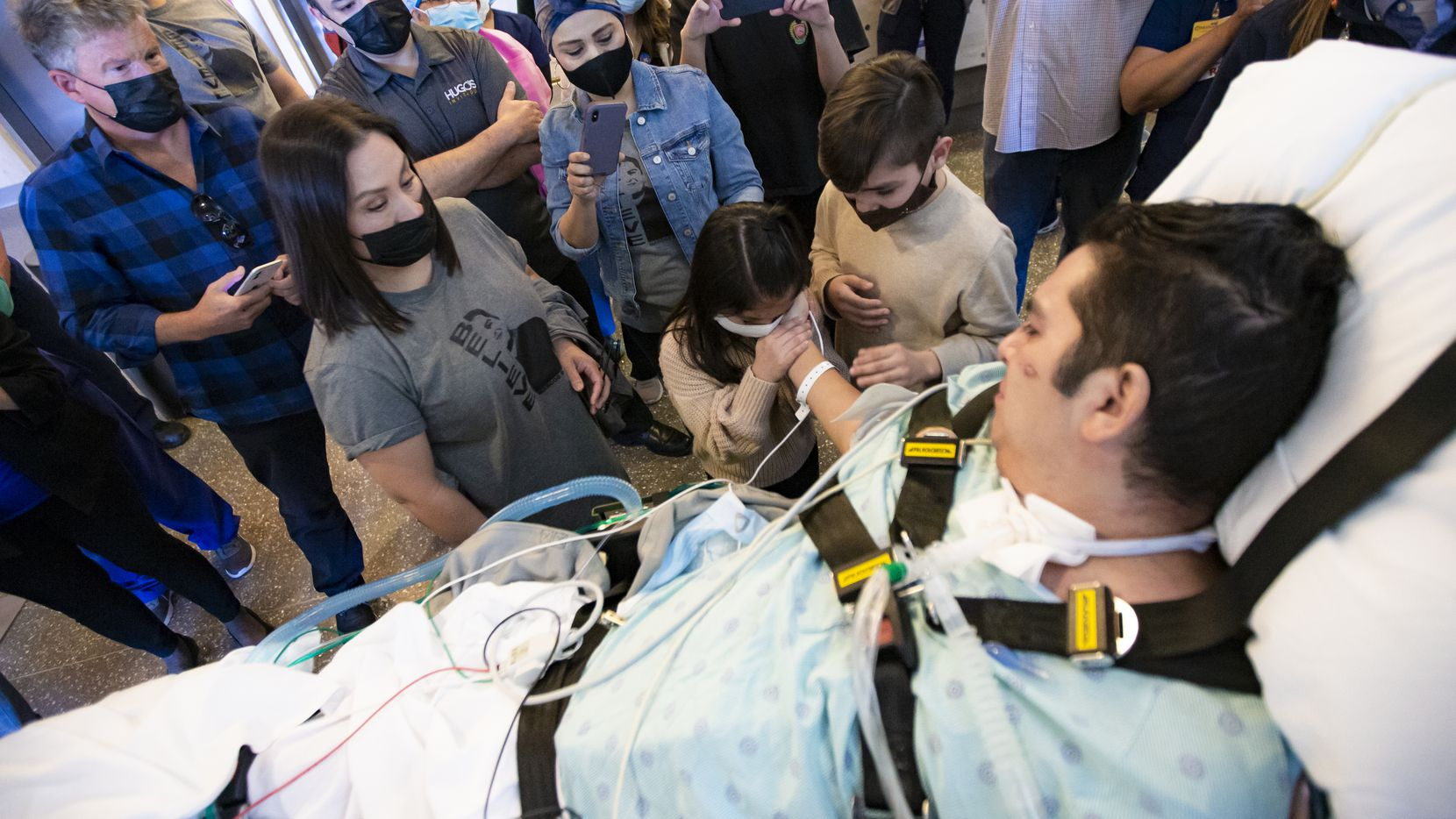 Hugo Miranda greets his daughter, Sophia, and son, Santiago, as he is released from Methodist Richardson Medical Center, after two and half months of battling COVID-19, Monday, March 15, 2021. Miranda will spend time in a rehab facility before going home. (Brandon Wade/Special Contributor)