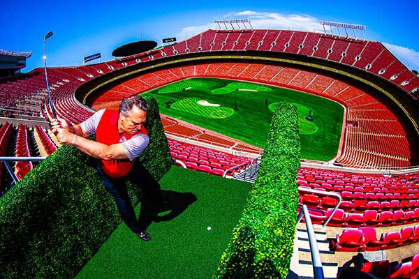 A golfer tees off inside Arrowhead Stadium in Kansas City, Mo., which was transformed into a nine-hole golf course by Stadiumlinks. The concept will be used at Globe Life Park in Arlington, Texas, on Nov. 18-20, 2016.