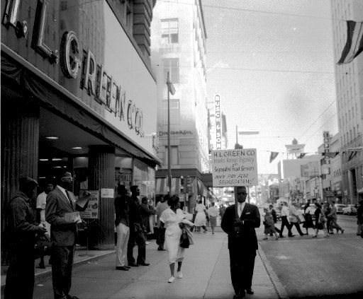 """NAACP Pickets the H.L. Green Company        Picket signs says:  """"H.L. Green Co. Insults Human Dignity with Segregated Food Services. Why Pay for Segregation!"""" Dallas History and Archives Division, Dallas Public Library."""