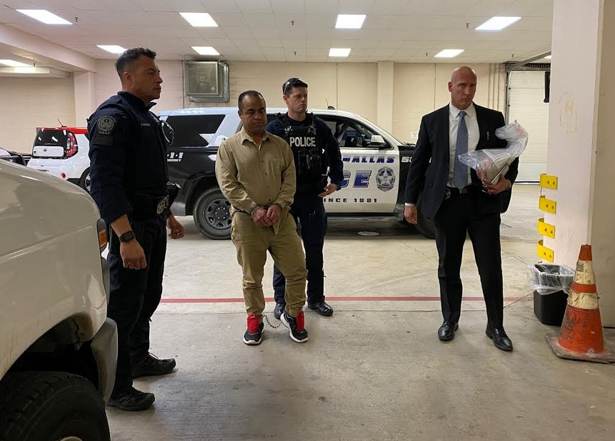 Fugitive Jose Sifuentes, captured last April in Mexico, is transferred to the custody of Dallas authorities in a photo provided by Dallas police.