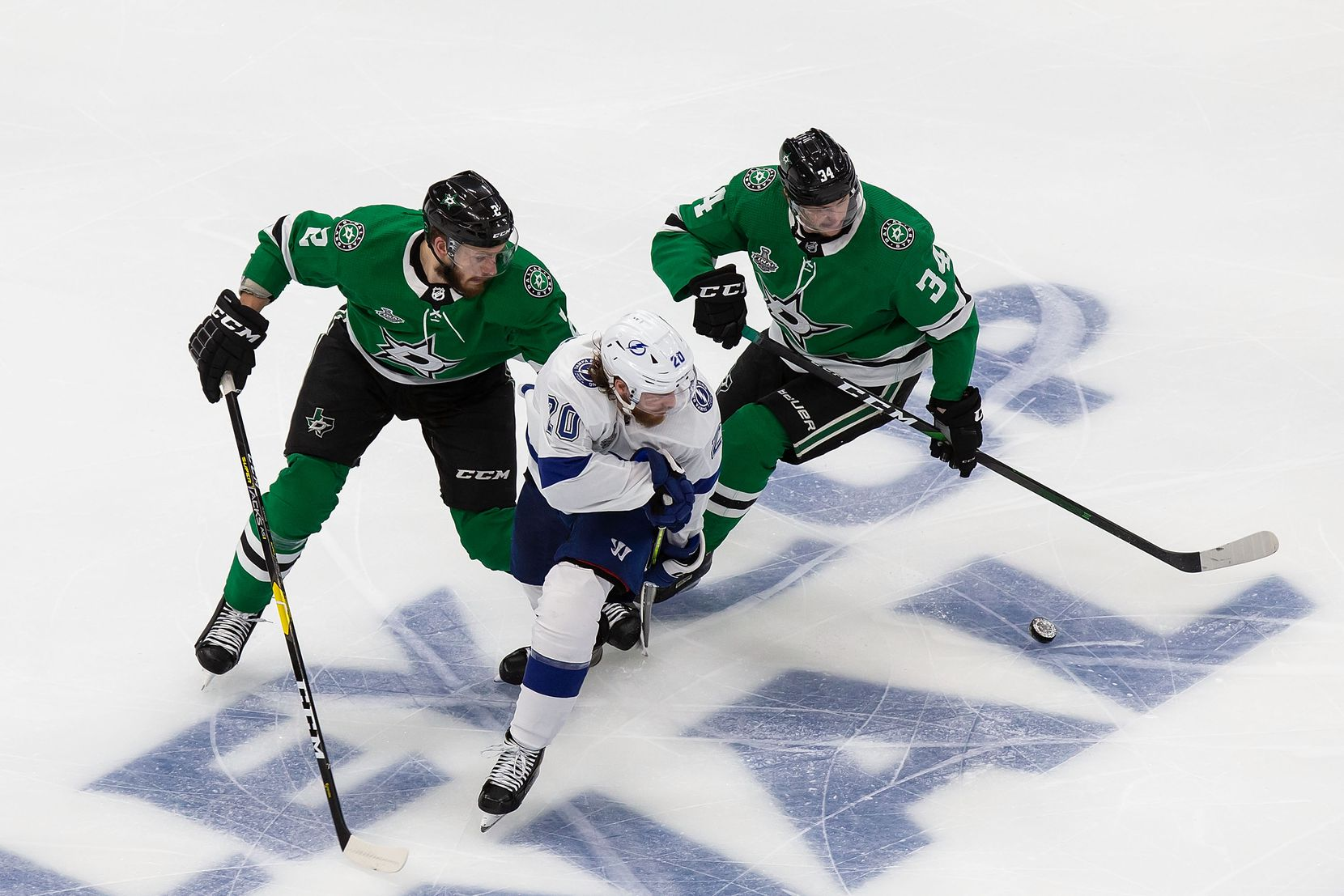 Jamie Oleksiak (2) and Denis Gurianov (34) of the Dallas Stars pursue Blake Coleman (20) of the Tampa Bay Lightning during Game Three of the Stanley Cup Final at Rogers Place in Edmonton, Alberta, Canada on Wednesday, September 23, 2020. (Codie McLachlan/Special Contributor)