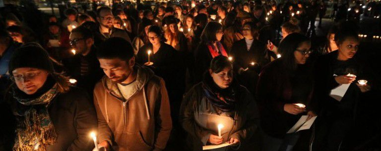 At a candlelight vigil outside the home of Baylor University President Ken Starr on Feb. 8, students and others called for reforms in the handling of sexual assault complaints. (Rod Aydelotte/Waco Tribune-Herald)