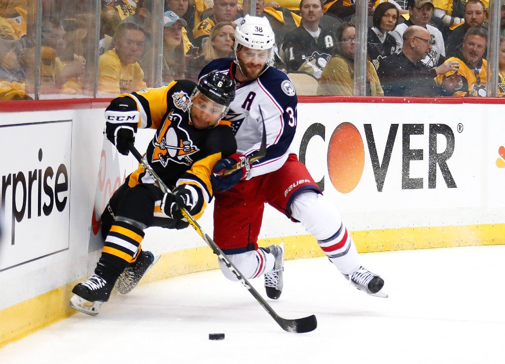 PITTSBURGH, PA - APRIL 12: Trevor Daley #6 of the Pittsburgh Penguins tries to control the puck in front of Boone Jenner #38 of the Columbus Blue Jackets during the first period in Game One of the Eastern Conference First Round during the 2017 NHL Stanley Cup Playoffs at PPG Paints Arena on April 12, 2017 in Pittsburgh, Pennsylvania.  (Photo by Gregory Shamus/Getty Images)