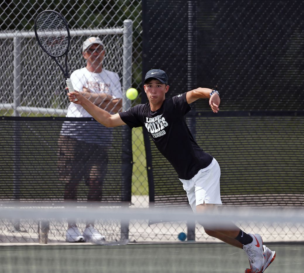 Plano West's Ethan Scribner returns a serve in a 6A boys double match at the UIL State Tennis finals at Northside Tennis on Friday, May 21, 2021.