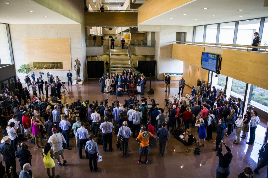 Members of the media gather as Texas Governor Greg Abbott and Dallas Mayor Mike Rawlings speak during a press conference on Friday, July 8, 2017 at Dallas City Hall in downtown Dallas, Texas. They stood in front of a group of Dallas city councilmen, state representatives, state senators and Texas Attorney General Ken Paxton (center). They made comments about a shooting on Thursday, July 7, 2016 in downtown Dallas that targeted police officers and left five people dead and seven more injured. (Ashley Landis/The Dallas Morning News)