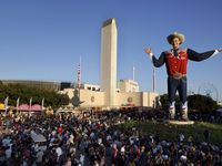 Crowds fill Big Tex Circle to see the larger-than-life cowboy and the Tower Building during the State Fair of Texas at Fair Park in Dallas, Monday, October 11, 2021.
