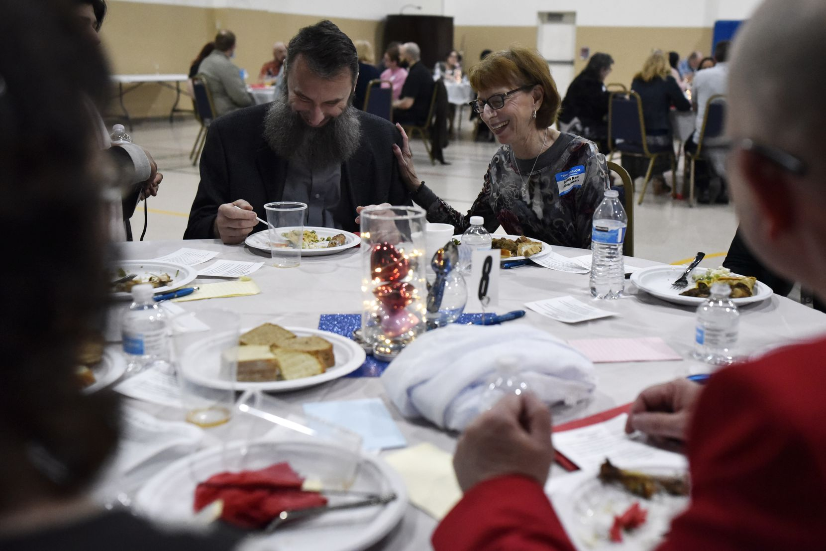 Lonna Rae Silverman (right) of the Temple Shalom steering committee reacts with laughter while speaking with Imam Shpendim Nadzaku of the Islamic Association of North Texas and other leaders during a Friends for Good event.