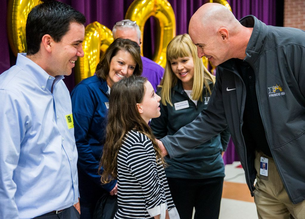 Sixth-grader Alanna Mazeffa, 11, talked to Frisco ISD Superintendent Mike Waldrip after she was celebrated as the 60,000th student to be enrolled in Frisco ISD at a celebration Tuesday at Pioneer Heritage Middle School in Frisco. Her father, Ryan Mazeffa, is at left. Alanna and her family recently moved from Pittsburgh, Pa.
