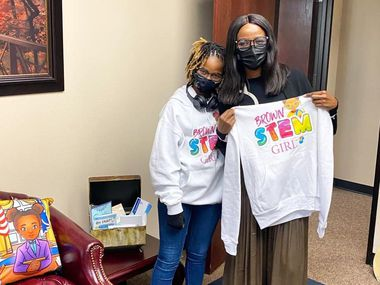 12-year-old Alena Wicker stopped by DeSoto City Hall last week to give Mayor Rachel Proctor her Brown Stem Girl sweatshirt.