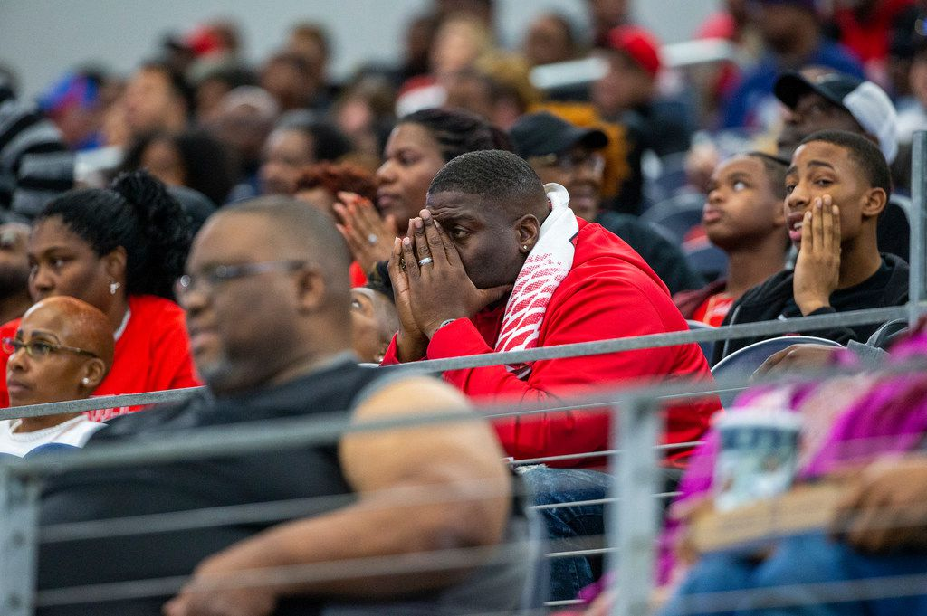 Cedar Hill fans react in shock after Denton Guyer recovers a fumble during the second half of a Class 6A Division II area-round high school football playoff game at the AT&T Stadium in Arlington, Texas, on Saturday, November 23, 2019. (Lynda M. Gonzalez/The Dallas Morning News)