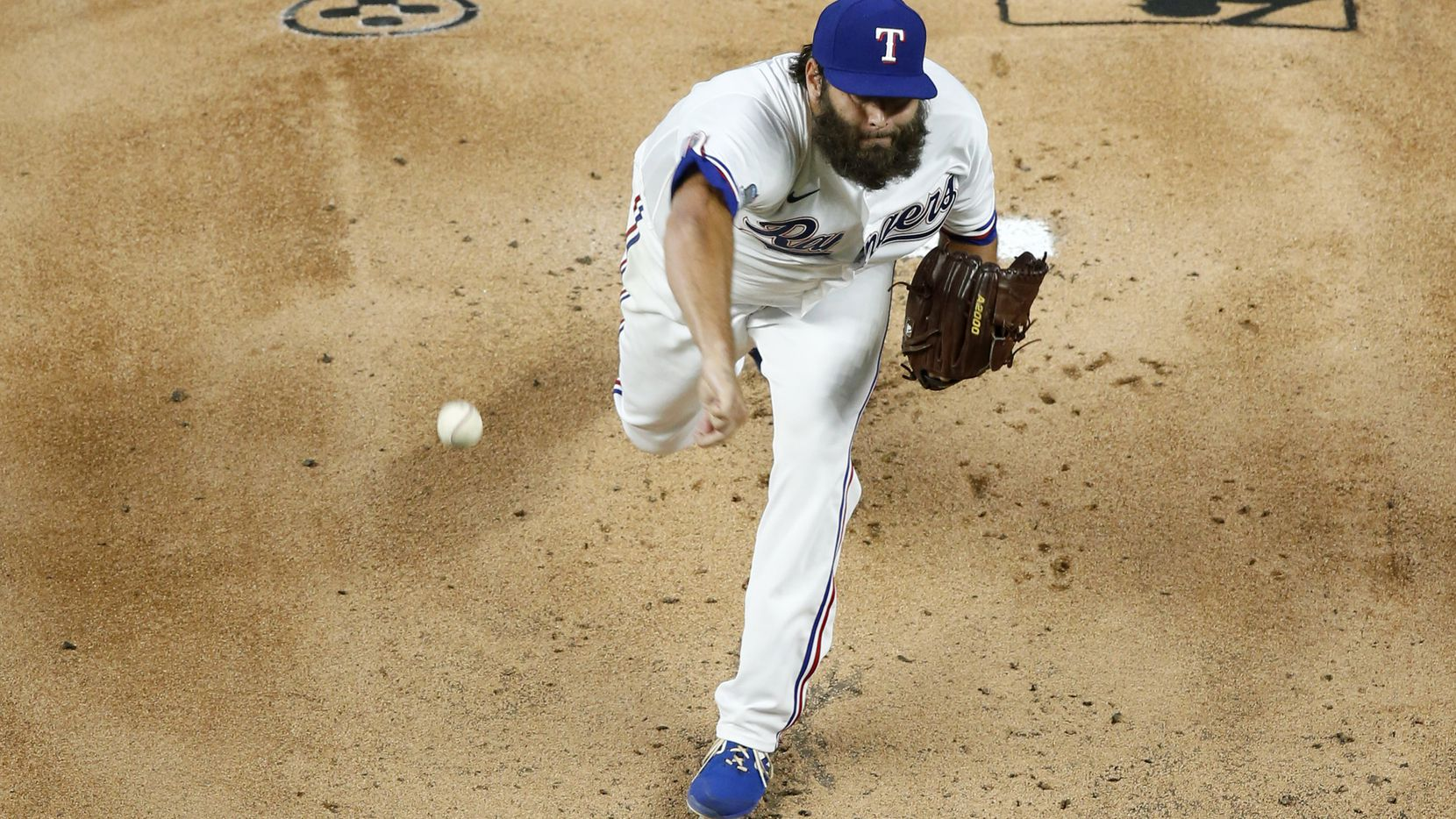 Texas Rangers starting pitcher Lance Lynn (35) pitches during the first inning agains the Colorado Rockies on opening day at Globe Life Field in Arlington, Texas on Friday, July 24, 2020. (Vernon Bryant/The Dallas Morning News)
