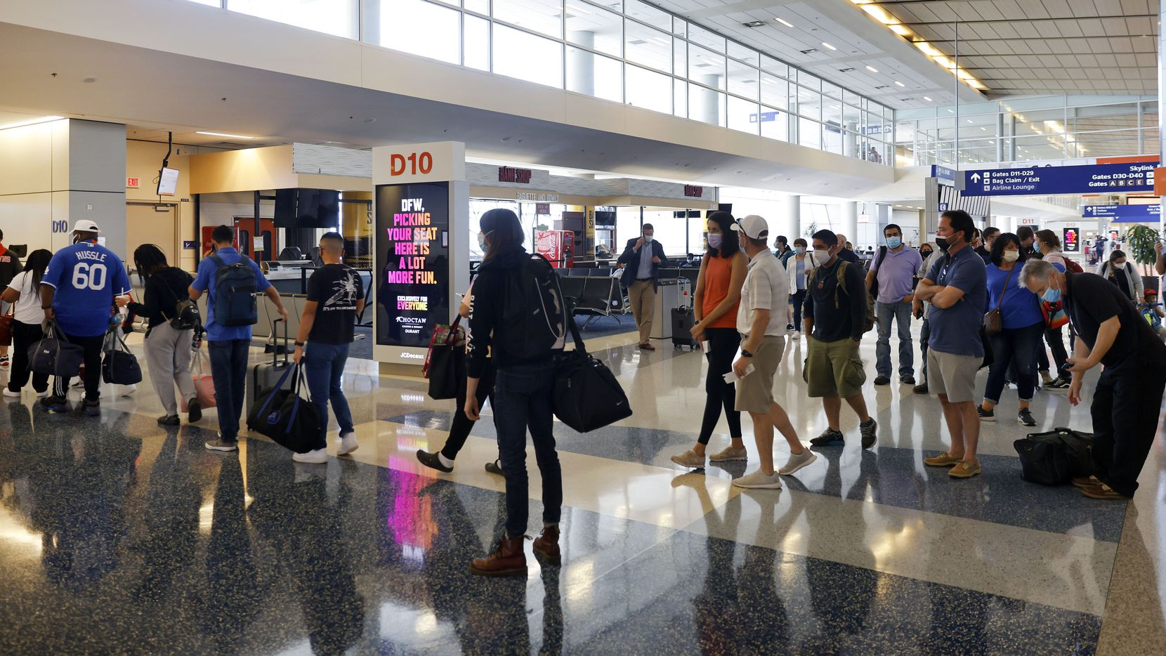 Passengers board a flight to Phoenix in Terminal D at Dallas-Fort Worth International Airport, Thursday, May 6, 2021. (Tom Fox/The Dallas Morning News)