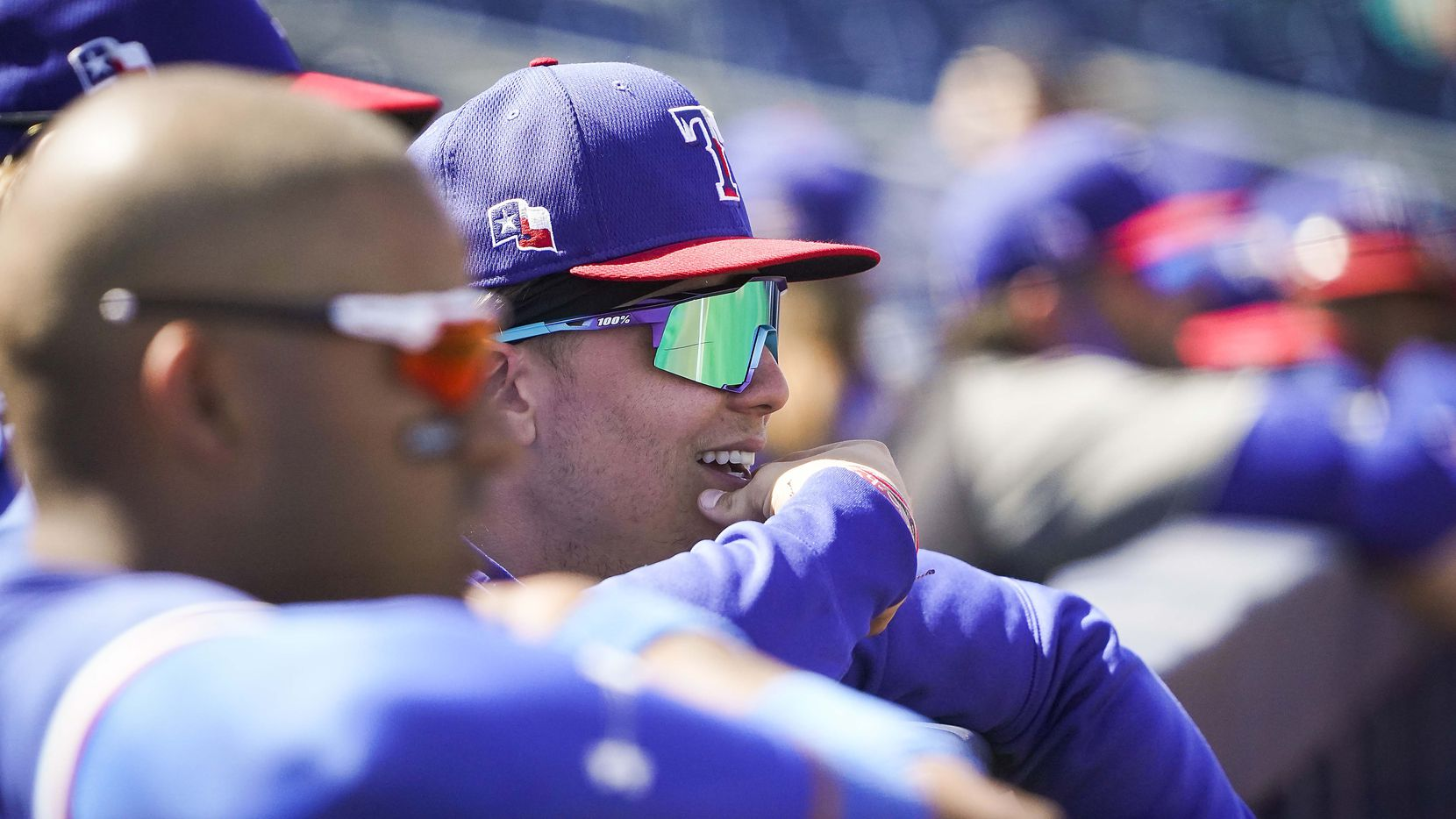 Texas Rangers outfielder Steele Walker watches from the dugout during a spring training game against the Seattle Mariners at Peoria Sports Complex on Wednesday, March 10, 2021, in Peoria, Ariz.