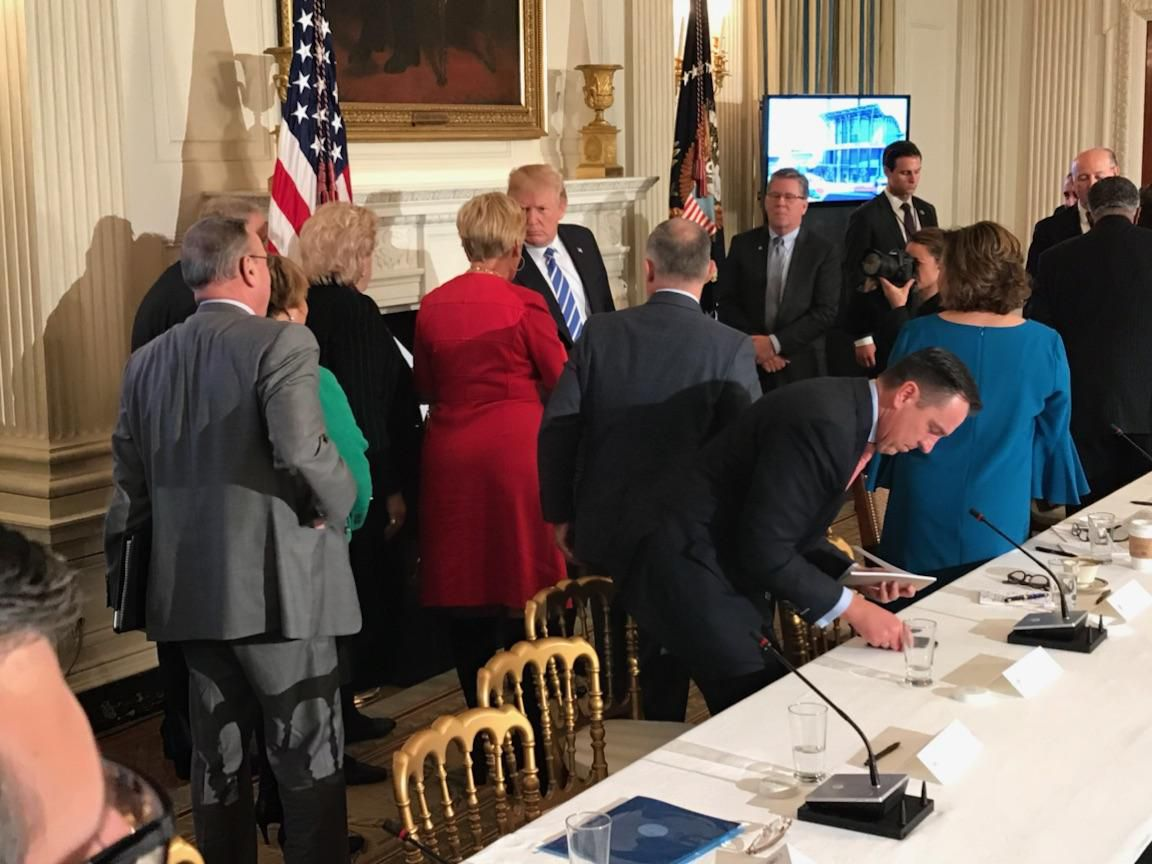 Fort Worth Mayor Betsy Price, in red, meets with President Donald Trump on Monday, Feb. 12, 2018, after he unveiled his infrastructure plan.