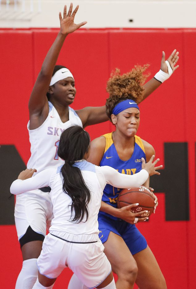 Lakeview Centennial senior Sanaa Baker, right, battles, Skyline sophomores Kennedi Johnson, foreground, and Jaida McDonald, background, for space during a girls basketball first-round playoff game at Hillcrest High School in Dallas, Saturday, February 13, 2021. Skyline won 49-42. (Brandon Wade/Special Contributor)