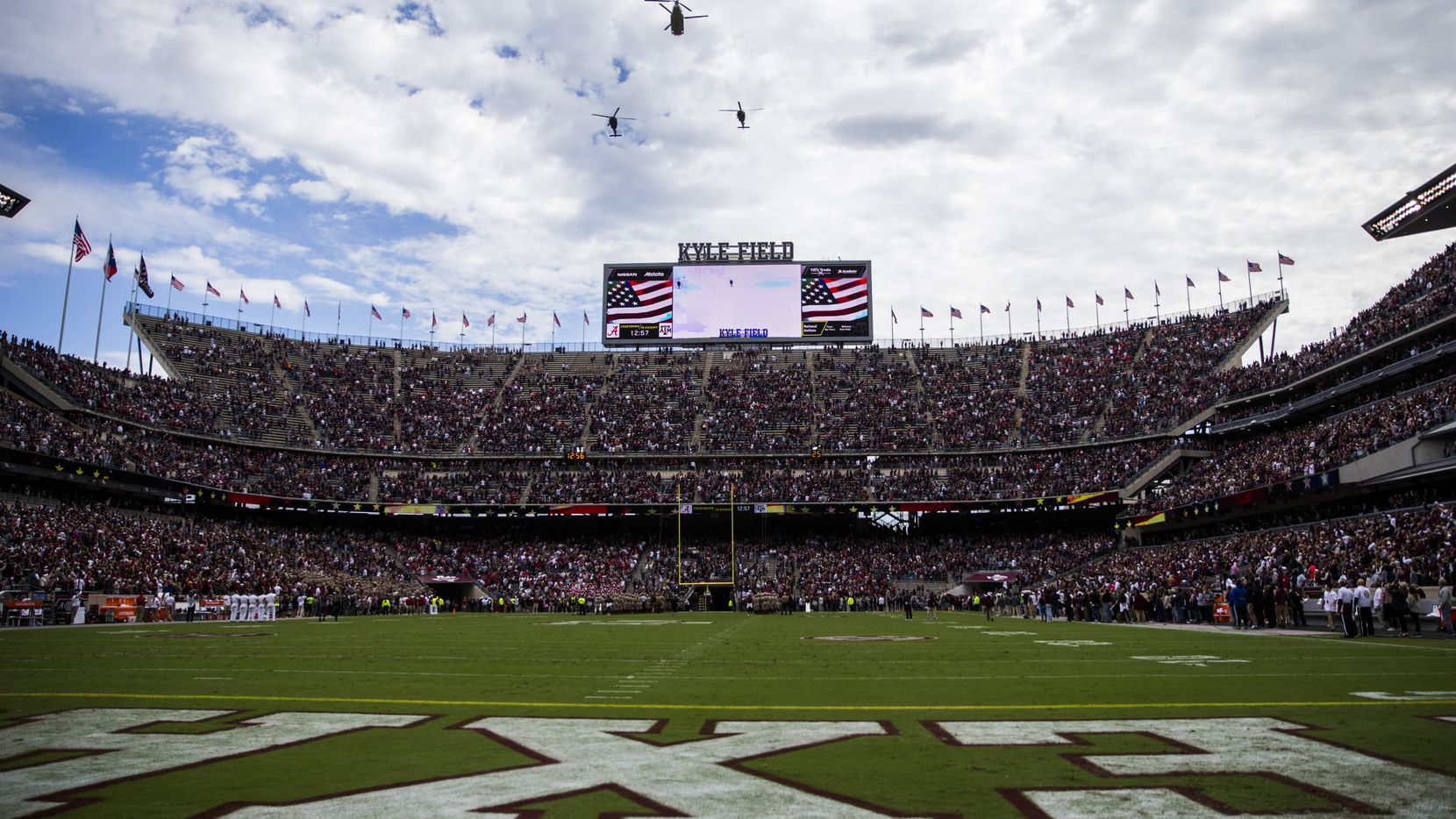 FILE - Helicopters fly over Kyle Field before a game between Texas A&M and Alabama on Saturday, Oct. 12, 2019, in College Station.