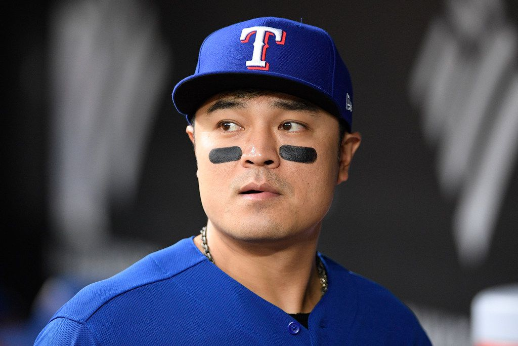 FILE - Rangers outfielder/designated hitter Shin-Soo Choo looks on from the dugout before a game against the Orioles on Friday, Sept. 6, 2019, in Baltimore. (AP Photo/Nick Wass)