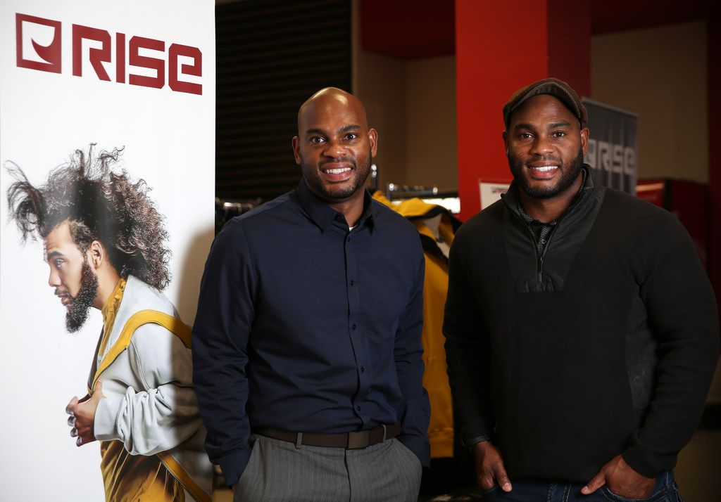 Tim Maiden (left) and Terrence Maiden stand in front of their RISE clothing store at the Duncanville Fieldhouse.