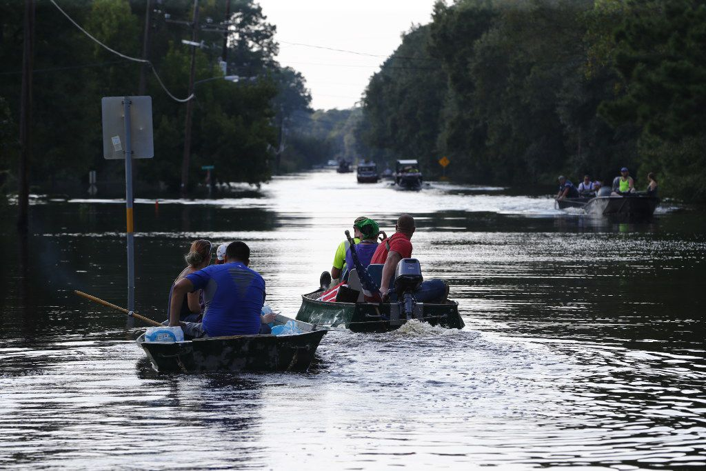 Boats attempt to resupply Pine Forest down FM 1131 going west after Hurricane Harvey near Vidor, Texas, on Sept. 3, 2017.