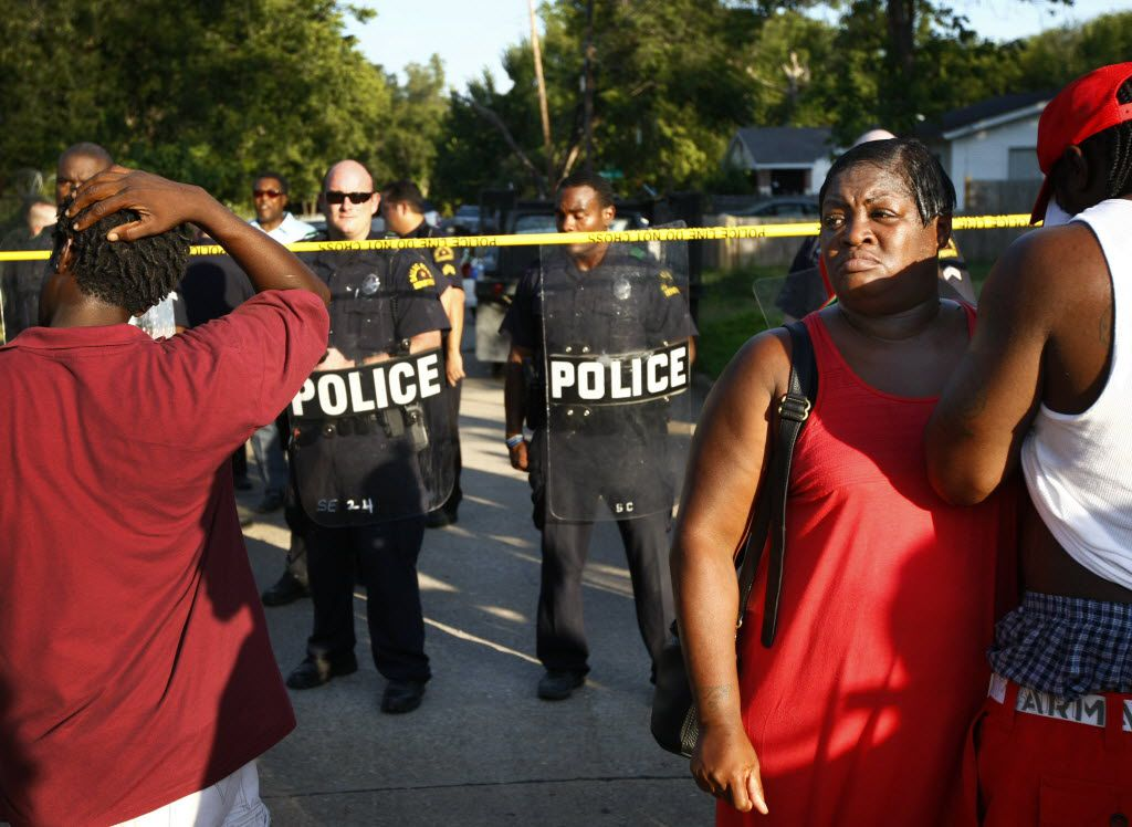 Lashaun Bradford joined others at a police line on Barber Avenue protest the shooting of James Harper in July 2012.
