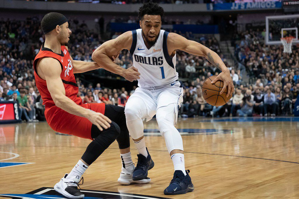 Dallas Mavericks guard Courtney Lee (1) dribbles around Portland Trail Blazers forward Zach Collins (33) during the second half of an NBA basketball game at American Airlines Center on Sunday, Feb. 10, 2019, in Dallas. (Smiley N. Pool/The Dallas Morning News)