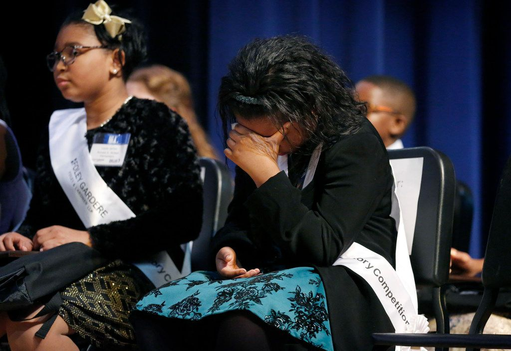 Eventual winner Jasira King, a fourth-grader at William Brown Miller Elementary School, hangs her head nervously as the top three winners are announced in the 27th annual Foley Gardere MLK Jr. Oratory Competition.