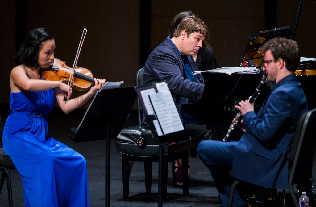 Violinist Grace Kang Wollett, pianist Mikhail Berestnev and clarinetist Danny Goldman rehearse before a Basically Beethoven Festival concert on July 7, 2019 at Moody Performance Hall in Dallas.