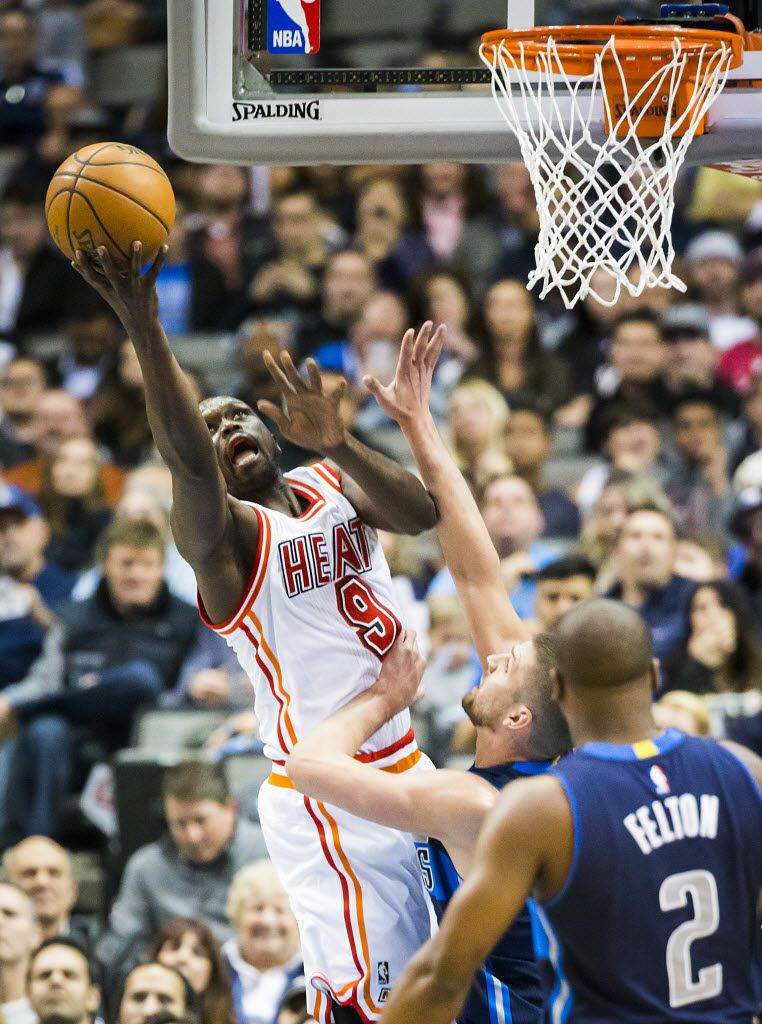 Miami Heat forward Luol Deng (9) puts up a shot over Dallas Mavericks forward Chandler Parsons during the first half of an NBA basketball game at American Airlines Center on Wednesday, Feb. 3, 2016, in Dallas. (Smiley N. Pool/The Dallas Morning News)