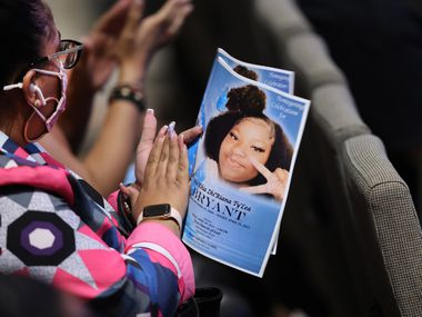 A mourner holds a funeral program during services for 16-year-old Ma'Khia Bryant at First Church of God on April 30 in Columbus, Ohio. Bryant was shot and killed on April 20 by a Columbus police officer answering a call for a domestic dispute.