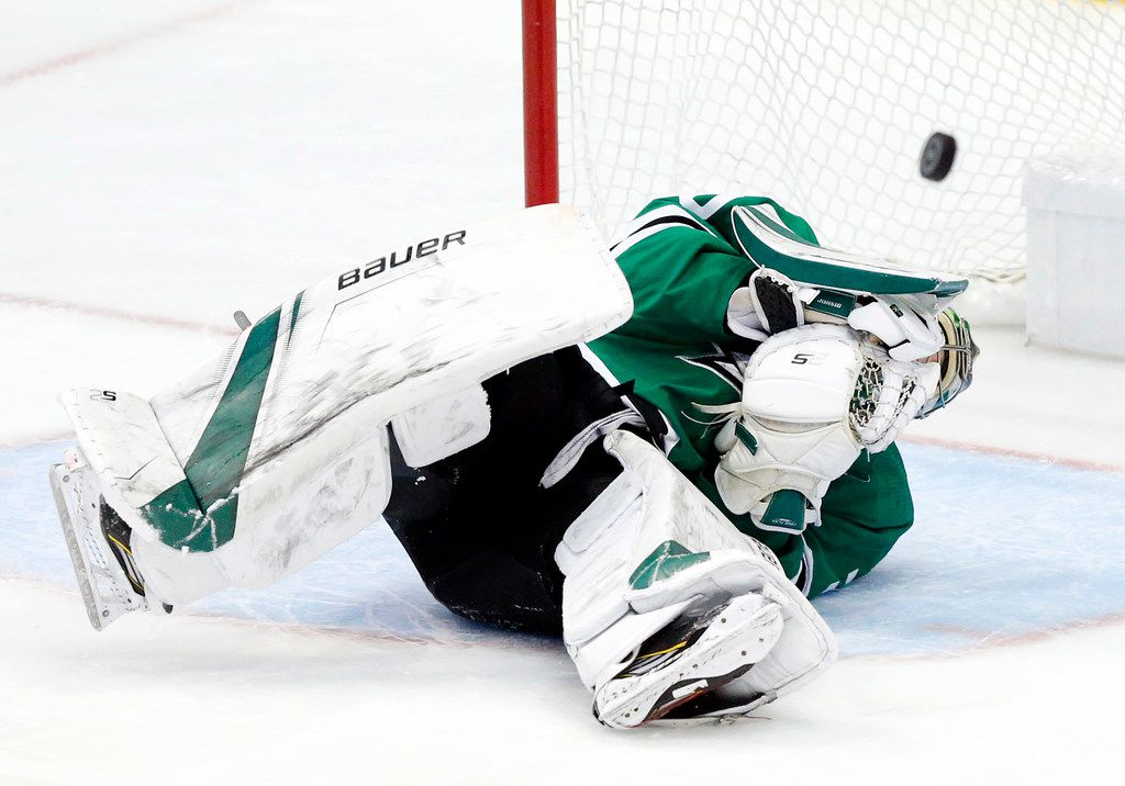 The puck bounces back into play after Dallas Stars goaltender Ben Bishop (30) took a slapshot by St. Louis Blues defenseman Colton Parayko (55) during the third period at the American Airlines Center in Dallas, Sunday, May 5, 2019. The teams were playing Western Conference Second Round Game 6 of the 2019 NHL Stanley Cup Playoffs. The Stars lost to the St. Louis Blues, 4-1. (Tom Fox/The Dallas Morning News)