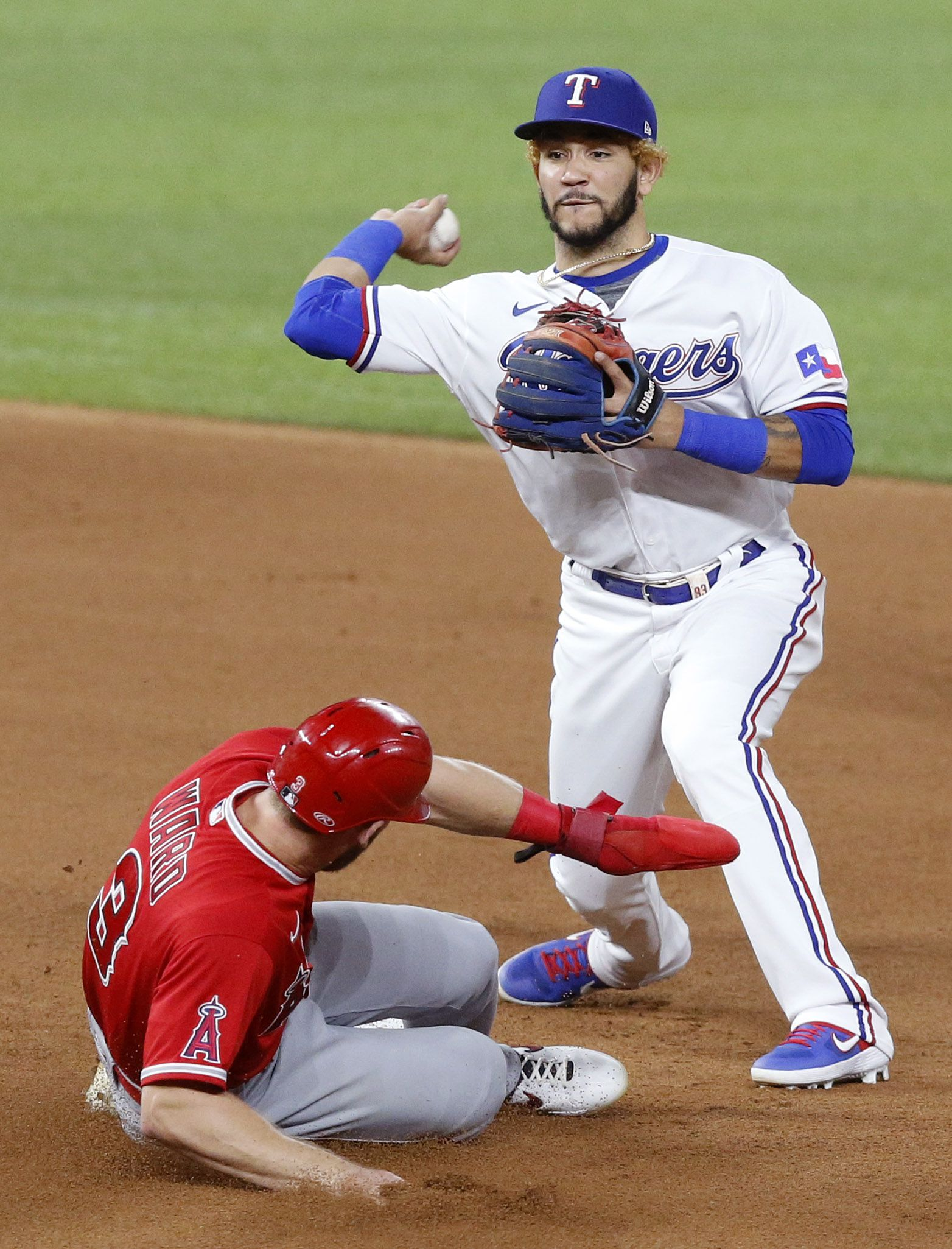Texas Rangers second basemen Anderson Tejeda (71) turns the front end of a double play getting Los Angeles Angels Taylor Ward (3) during the fourth inning at Globe Life Field in Arlington, Texas, Tuesday, September 8, 2020. (Tom Fox/The Dallas Morning News)