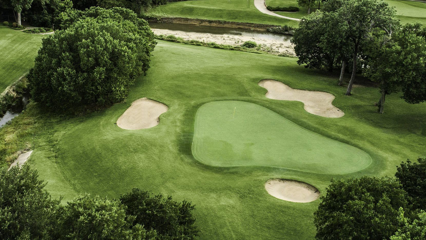 Iron Horse Golf Course in North Richland Hills, Texas, will formally re-open to the public Saturday, Sept. 19, 2020 following an extensive $3 million renovation. The renovation was overseen by Jeff Brauer, a golf course architect based in Arlington, Texas. Pictured is the fifth hole. Pictured is the 212-yard par-3 fifth hole.