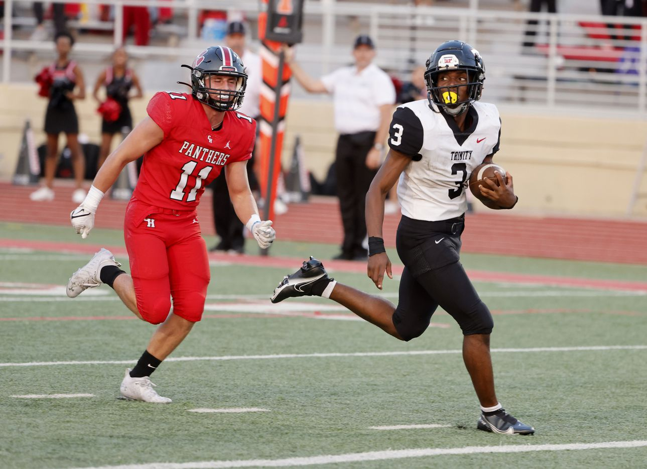Trinity running back Gary Maddox (3) scores a rushing touchdown in front of Colleyville Heritage defender Brannan Mannix (11) during the first half of a high school football game in Grapevine, Texas on Friday, Sept. 10, 2021. (Michael Ainsworth/Special Contributor)