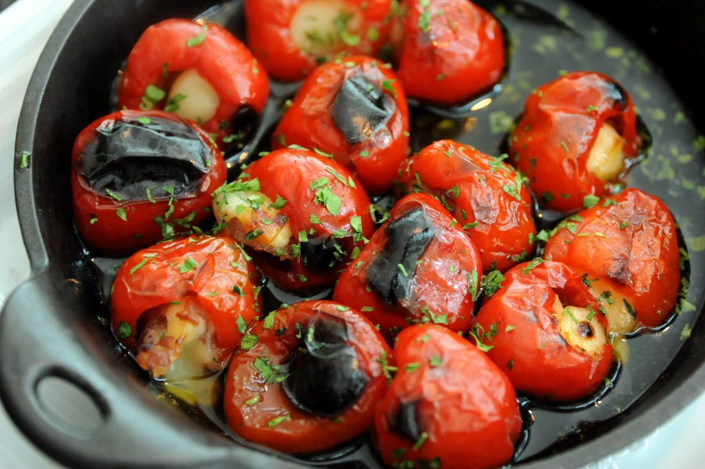 The provolone stuffed peppers are made with smoked provolone, prosciutto and basil.