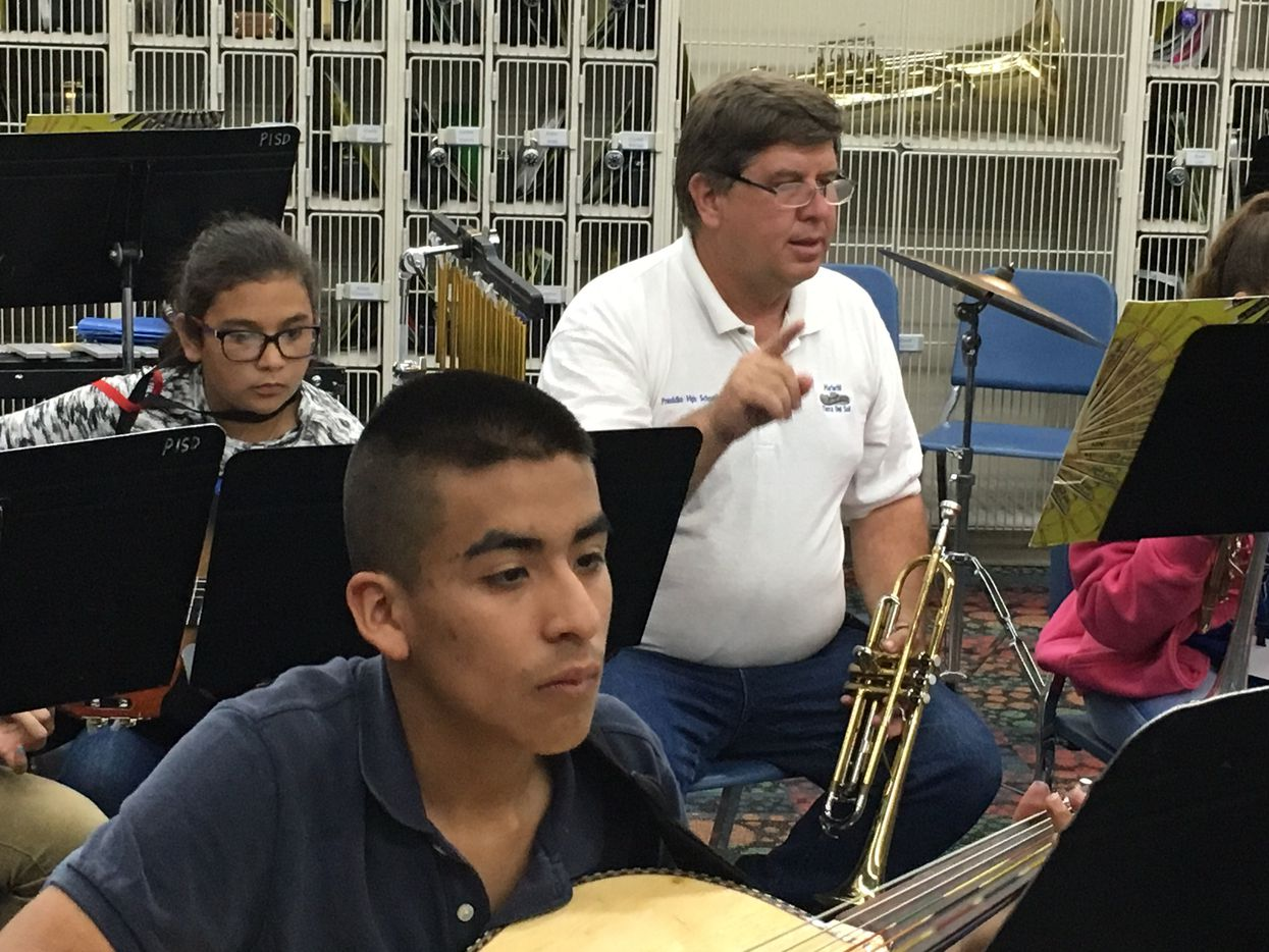 John Ferguson leads students during mariachi band practice.  He serves as the middle school mariachi band director and mayor of the town.