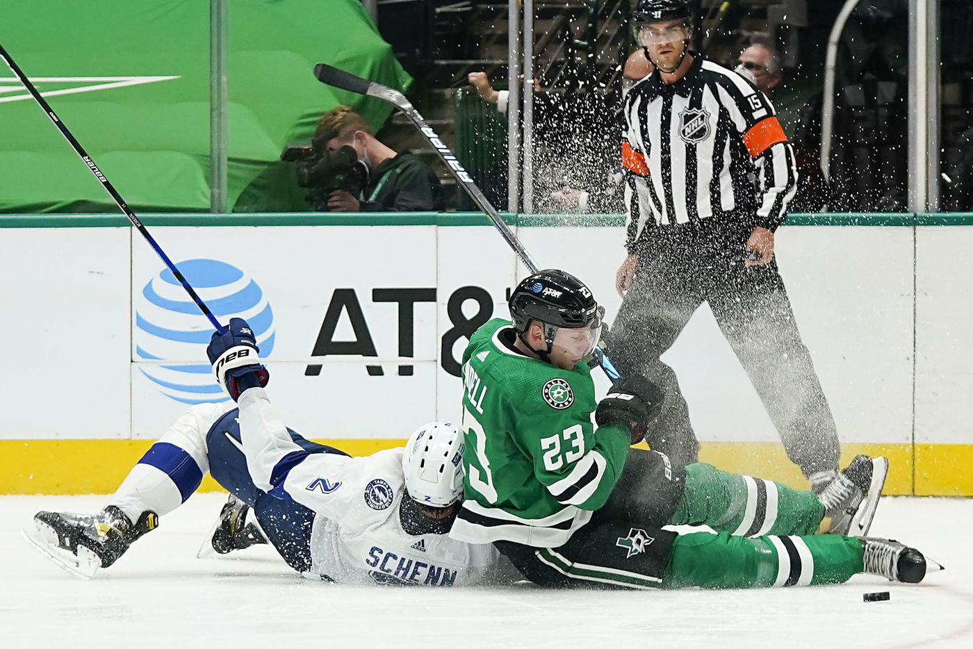 Dallas Stars defenseman Esa Lindell (23) fights for the puck against Tampa Bay Lightning defenseman Luke Schenn (2) as they hit the ice during the second period of an NHL hockey game at the American Airlines Center on Thursday, March 25, 2021, in Dallas. (Smiley N. Pool/The Dallas Morning News)